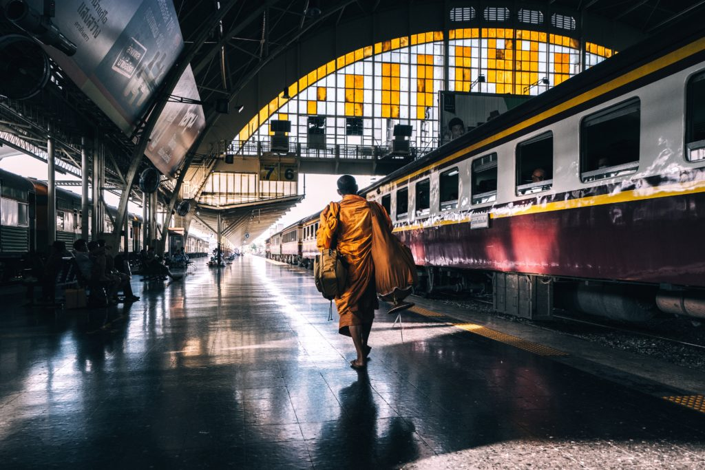 monk in train station